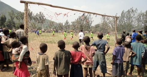 children watching football game